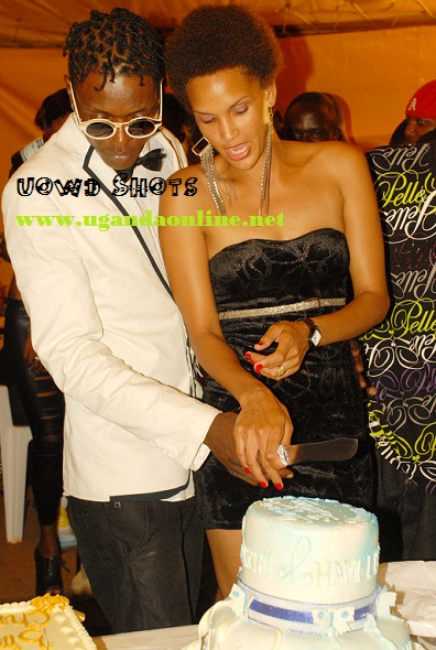 Jose and wife cutting a cake at Club Silk