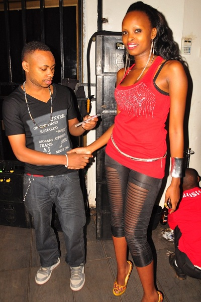 Yiya Moses with a babe during the airtel Tsup party
