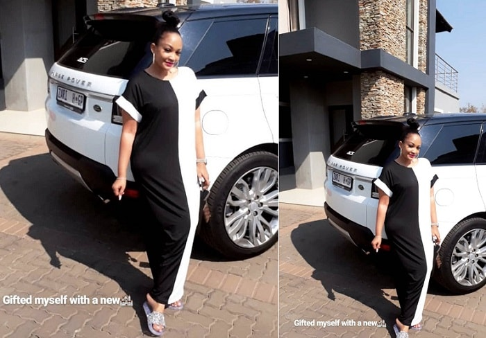 Zari next to her white rover sport and in the background is her latest house