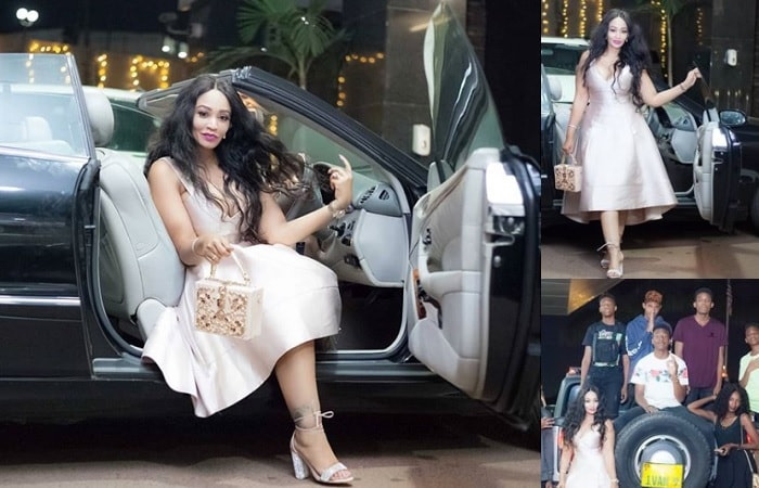 Zari strikes a pose in her convertible and inset are her soldiers